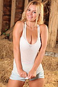 Busty babe Summer St Claire strips off in the barn