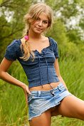 Sexy blonde teen Valesca gets naked down by the water