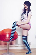 Zoe Moore teases in hooped over the knee socks