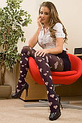 Jess Impiazzi teases in the office in sexy fashion tights