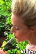 Becky Roberts smokes a cigarette - topless of course