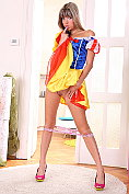 Gina, dressed as Snow White, masturbates with a huge glass dildo