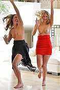 Two sexy girls start off larking about but end up getting off together