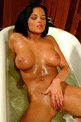 Busty pornstar Lanny Barby takes a bath at BustyOnes