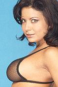 Gina Ryder takes off her provocative black mesh bikini