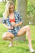 Blonde babe Sam Tye gets naked outdoors