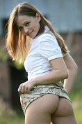 Julia unbuttons her shirt and lifts up her skirt for you to see