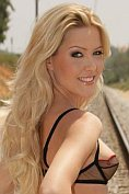 Blonde babe Sophie Sweet strips naked on the railway line
