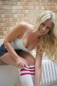 Billie Judd takes off her denim socks and knee high socks