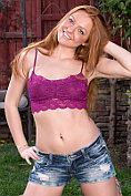 Naughty redhead Farrah Flower strips and spreads in the garden
