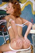 Redhead teen rubbing tight pussy