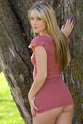 Lovely blonde Jewel A takes off her dress outdoors