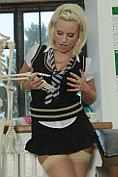 Billie Evans strips out of her slutty school uniform
