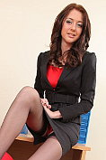 Slender babe Natalie Thomas teases and strips in the office