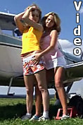 Two hot girls make out on the wing of an aeroplane on video