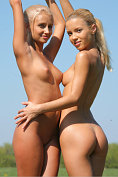 Two perfect blondes play naked in the open