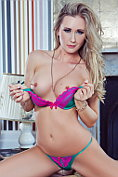 Sam Tye strips out of her brightly coloured lingerie