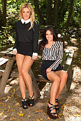 Amy Green and Zoe Alexandra undress each other in the woods