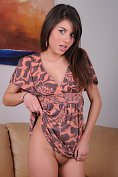 Shyla lifts up her summer dress to show off her shaven  pussy