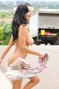 Busty babe strips and shows off her body by the roadside