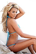 Rachel-Louise Frodsham takes off her little blue bikini