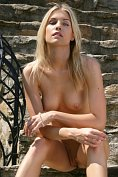 Iveta B is naked on the outside stairs