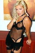 Sexy blonde pornstar Sophie Moone takes off her sluttiest black lingerie for you
