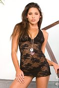 Hot babe Zafira posing in sexy see-through black dress