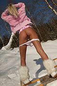 Hot blonde using her golden dildo out in the snow