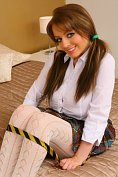 Huge breasted babe strips out of her school girl costume