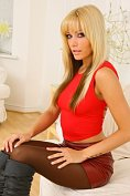 Sexily clad blonde teasingly undresses