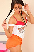 Felicity Hill strips out of her Hooters outfit