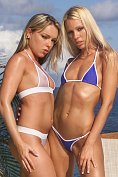 Sandy and Trish get naked by the pool