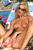 Bambi masturbates her hairless pussy by the pool
