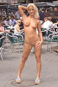 Hot blonde goes nude in the town centre