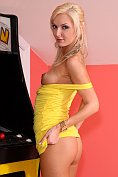 Gorgeous blonde takes off her yellow dress and pleasures herself