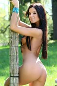 Jessie A is a beautiful brunette, naked in the trees