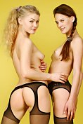 Bella A and Ashanti A in suspender tights