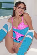 Teen cutie Danni Cole in her tight blue socks stripping off her panties and flashing her lips