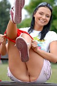 Tina takes off her panties in the park