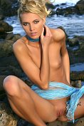 Gorgeous slim blonde Lilly A naked on the rocks
