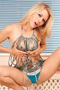 Michelle Moist shows off in a slutty dress