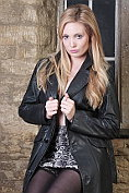 Hot babe Louise is wearing a very sexy long trench coat with nothing but her lingerie underneath