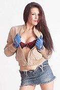Naughty Milf Tina teases in leather knee high boots and takes off her bra with her sexy blue leather gloves