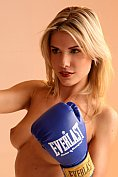 Gorgeous blonde babe practices kick boxing