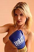 Gorgeous blonde babe practices kick boxing