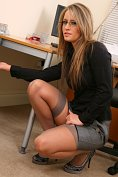 Sexy secretary in stockings strips off