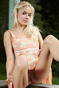 Gorgeous little blonde Aljena A takes off her summer dress