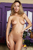 Fabulous blonde shows off her naked body