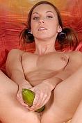 Horny girl sucks and fucks on a big green fruit